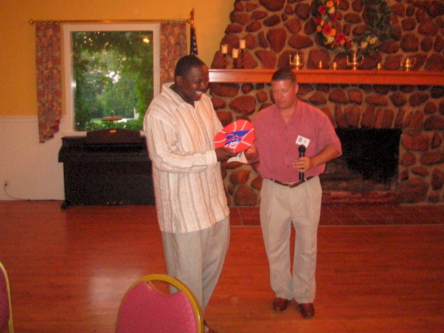 "Ibn Gaskins receiving the ""Classmate who came the farthest"" Award (Brooklyn) from Master of Ceremonies: Roger Fincher"